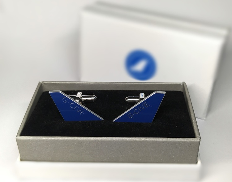 A pair of cufflink made from real aircraft skin presented in a box